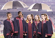 Students from Lincoln Northstar High School sing the national anthem under the cover of umbrellas before the Class B state title game between Elkhorn South and Omaha Skutt at Memorial Stadium on Tuesday, Nov. 22, 2016, in Lincoln.<br /> <br /> MATT DIXON/THE WORLD-HERALD