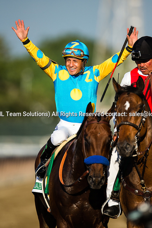 June 06, 2015: Victor Espinoza rides American Pharoah to becomes the first triple crown winner since Affirmed in 1978, in the 147th running of the  Belmont Stakes at Belmont Park in Hempstead, NY.
