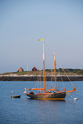 Two-masted schooner in Gosport Island as seen from Star Island, Rye, New Hampshire. Isles of Shoals.