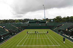 © Licensed to London News Pictures. 27/06/2016. Boy balls and ball girls prepare court no.3 on the first day of the WIMBLEDON Lawn Tennis Championships in London, UK. Photo credit: Ray Tang/LNP