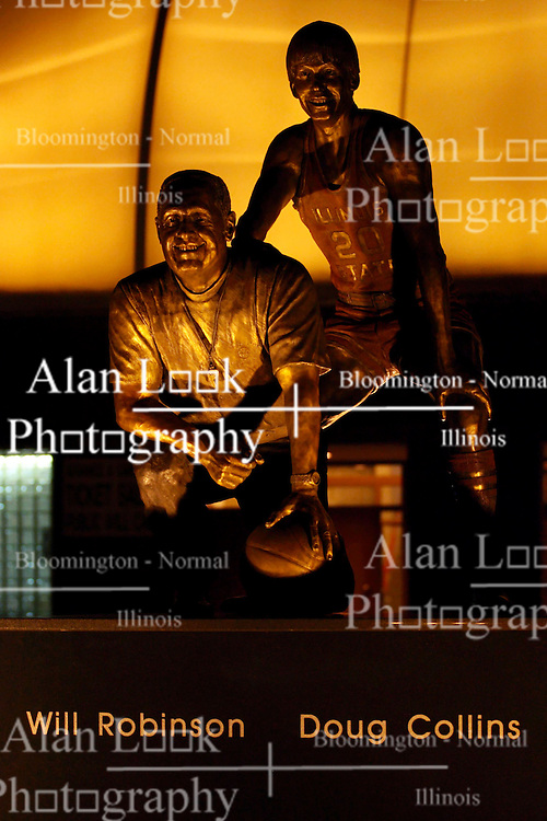26 February 2010: Night shot of the Will Robinson Doug Collins bronze staute outside Redbird Arena at Illinois State University in Normal Illinois
