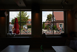 Leah Kirchmann (CAN) and Lisa Brennauer (GER) pass a frites shop at Boels Ladies Tour 2018 - Stage 3, a 129km road race in Gennep, Netherlands on August 30, 2018. Photo by Sean Robinson/velofocus.com