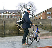 London, Great Britain.  Sir Matthew PINSENT, Umpire, prepares to cycle home, after Pre Boat race fixture over the Championship Course  River Thames. Single race piece - Putney to Chiswick Pier.  on Saturday  12/03/2011 [Mandatory Credit; Karon Phillips/Intersport Images]..