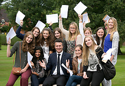 © Licensed to London News Pictures.22/08/2013. Solihull, West Midlands, UK. Solihull School achieved outstanding GSCE Level Results this year, up on previous years, with 77% of pupils gaining A grade or A Stars. Pictured, pupils celebrate vwith headmaster David Lloyd,centre. Photo credit : Dave Warren/LNP