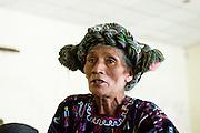 A woman member of the AJR questions her representatives at a meeting organised by the AJR and the Guatemalan human rights group CALDH, to report back on developments with the legal process following recent arrests in the genocide cases. <br /> The AJR is an association of survivors of massacres committed during the armed conflict.<br /> Nebaq, El Quiche, Guatemala, October 2011.