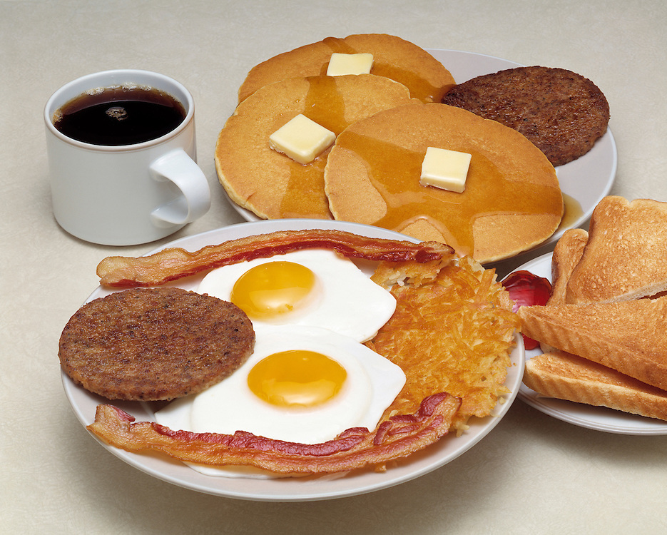hearty fast food breakfast assortment two 2 fried eggs sunny side up sausage patty bacon strips hash brown home fry potatos traditional american breakfast Bon Appetit concept conceptual metaphor Cuisine pancake melted butter syrup toast jelly cup of coffee lifestyle travel Dine Entertaining Entice Enticing Fed Feed Feeding Flavor Flavorful Foodshot Fragrant Haute Gourmet Gourmand Good Gratify Gratifying Grocery Healthfood Hospitable Hospitality Ingredient Lunch Market Munchy Marketplace Natural Organic Portion Pretty Produce Refresh Refreshing Satisfying Satisfaction Seasonal Serve Serving Smell Still life