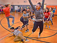 STRONG FINISH --- Columbia Elementary School fifth grader Kaniya Miller, right front, celebrates her team from Mr. Zvers class winning a round of the school-wide tug-of-war during last day of school field day activities at the Logansport school Thursday afternoon. J. Kyle Keener | Pharos-Tribune