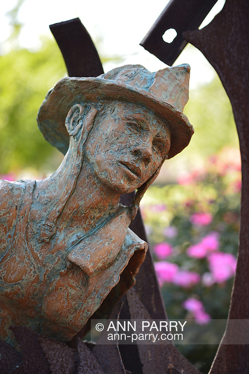 Garden City, New York, U.S. - August 29, 2014 - Adelphi University campus outdoor sculpture in terra cotta and metal of 9/11 theme by artists artist Dan Christoffel in summer