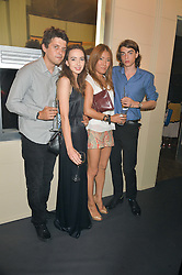 Left to right, FENTON BAILEY, SARAH STANBURY, MIMI NISHIKAWA and SASCHA BAILEY at the Tiffany & Co. Exhibition 'Fifth And 57th' Opening Night held in The Old Selfridges Hotel, Orchard Street, London on 1st July 2015.