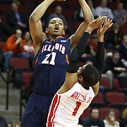 Malcolm Hill #21 of the Illinois Fighting Illini shoots the ball during the NIT First Round game at Agganis Arena on March 19, 2014 in Boston, Massachusetts . (Photo by Elan Kawesch)