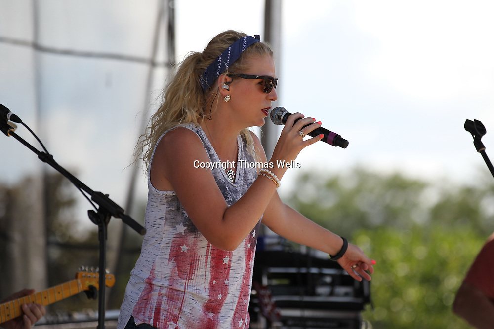 Musician Hanna Belle perfroms Tuesday's at Tupelo's July 4th picnic at Fairpark at get the day underway.