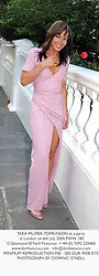 TARA PALMER-TOMKINSON at a party in London on 6th July 2004.PWW 180