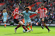 Willian (22) of Chelsea looks for a way past Pierre-Emile Hojbjerg (23) of Southampton and Wesley Hoedt (6) of Southampton during the Premier League match between Southampton and Chelsea at the St Mary's Stadium, Southampton, England on 7 October 2018.