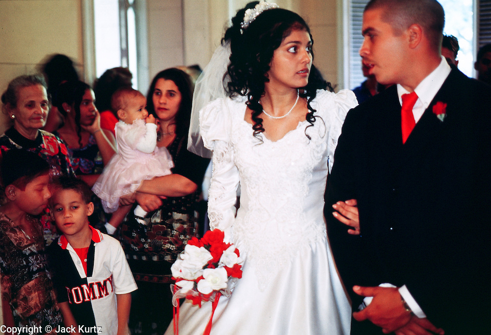 HAVANA, CUBA: A couple waits for their wedding to start in a government Palacio de Matrimonios (wedding palace) in Havana, Cuba, March 2000. Cuba?s is officially a secular state and weddings are civil affairs presided over by a government attorney. They take about 15 minutes and are held in government wedding offices.   PHOTO BY  JACK KURTZ       WOMEN   CULTURE   LIFESTYLE   FAMILY