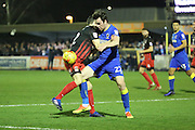 AFC Wimbledon defender Sean Kelly (22) tackling Coventry City midfielder Callum Reilly (12) during the EFL Sky Bet League 1 match between AFC Wimbledon and Coventry City at the Cherry Red Records Stadium, Kingston, England on 14 February 2017. Photo by Matthew Redman.