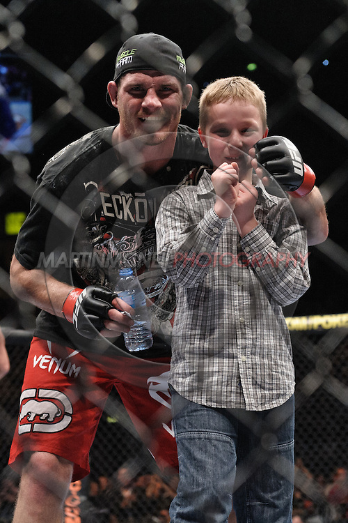 "MANCHESTER, ENGLAND, NOVEMBER 14, 2009: Michael Bisping poses with his son, Callum, following his victory at ""UFC 105: Couture vs. Vera"" inside the MEN Arena in Manchester, United Kingdom."