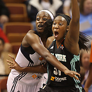 Chiney Ogwumike, (left), Connecticut Sun, the WNBA number one draft pick making her WNBA debut, challenges Tina Charles, New York Liberty and former Sun player during the Connecticut Sun Vs New York Liberty WNBA regular season game at Mohegan Sun Arena, Uncasville, Connecticut, USA. 16th May 2014. Photo Tim Clayton