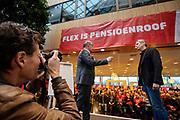 Voorzitter Han Busker (links) en vice-voorzitter Tuur Elzinga spreken de menigte toe. In Utrecht zijn zo'n duizend FNV-leden bij het vakbondshuis gekomen om als actieberaad te praten over de eerder besproken hoofdlijnen van het actieplan vast te stellen. De vakbond komt in actie na het mislukken van het pensioenakkoord waarvoor de vakbond de schuld heeft gekregen.<br /> <br /> Chairman Han Busker and vice- chairman Tuur Elzinga talk to the audience. In Utrecht around thousand members of the trade union FNV gather to discuss the actions the trade union has to take after the collapse of an agreement on the pensions with the government.