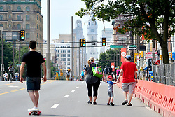 A boy in a Phillies cap looks over his shoulder as thousands of pedestrians, cyclist, skaters, joggers enjoy a closed off 4mi (6.4km) section of North Broad Street, in Philadelphia, PA, during the third annual Philly Free Streets event on August 11, 2018.