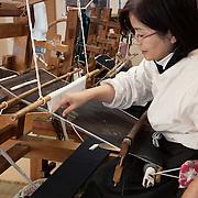 Yuki, (Ibaraki prefecture), Japan, January 2011. Traditional manifacture of Yuki Tsumugi traditional kimono.