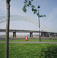 The Silver Jubilee road bridge in Runcorn which crosses the river Mersey to Widnes. The Mersey is a river in north west England which stretches for 70 miles (112 km) from Stockport, Greater Manchester, ending at Liverpool Bay, Merseyside. For centuries, it formed part of the ancient county divide between Lancashire and Cheshire.