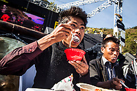 The Naga Chili Eating Competition at the Hornbill Festival in Nagaland, India. The Naga chili is called the hottest chili in the world. Contestants here have 20 seconds to eat as many chilis as possible. They are allowed to chew even after their 20 seconds are up, but if they spit out any chili, they are disqualified. They are given water and powdered milk to help ease the inevitable pain that accompanies eating copius amounts of the world's hottest chili.