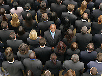 Back view of large group of business people man facing opposite direction elevated view
