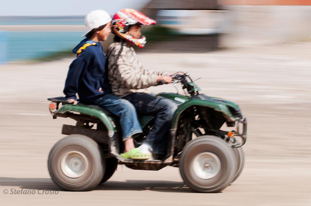 CANADA, Nunavut<br /> Inuit kids on quad