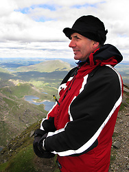UK WALES LLANBERIS 15JUN08 - Mountain rescue volunteer Elidir looks out from the summit of Mount Snowdon, the highest mountain in England and Wales in Snowdonia National Park, Wales...jre/Photo by Jiri Rezac ..© Jiri Rezac 2008..Contact: +44 (0) 7050 110 417.Mobile:  +44 (0) 7801 337 683.Office:  +44 (0) 20 8968 9635..Email:   jiri@jirirezac.com.Web:    www.jirirezac.com..© All images Jiri Rezac 2008 - All rights reserved.