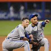 Josh Donaldson, (left), Toronto Blue Jays and team mate Ryan Goins during the New York Mets Vs Toronto Blue Jays MLB regular season baseball game at Citi Field, Queens, New York. USA. 15th June 2015. Photo Tim Clayton