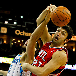Jan 1, 2013; New Orleans, LA, USA; Atlanta Hawks center Zaza Pachulia (27) and New Orleans Hornets power forward Ryan Anderson (33) battle for a loose ball during the second half of a game at the New Orleans Arena. The Hawks defeated the Hornets 95-86. Mandatory Credit: Derick E. Hingle-USA TODAY Sports