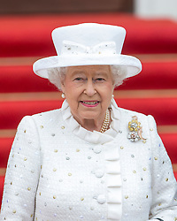 BERLIN-GERMANY- 24-JUNE-2015: Britain's  HM Queen Elizabeth II, accompanied by HRH The Duke of Edinburgh attends the State Ceremonial Welcome at the Schloss Bellevue in Berlin at the start of her State Visit to Germany.<br /> The Queen was met by German President Joachim Gauck.<br /> Photograph by Ian Jones