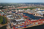 Nederland, Zuid-Holland, Schiedam, 23-05-2011; .Zicht op Schiedam met in de voorgrond bedrijfsterrein van Mammoet zwaar hijs- en transport met kantoorgebouw De Bolder.  Wiltonhaven..View on Schiedam, foreground the compund of the lifting heavy transport company Mammoet, .luchtfoto (toeslag), aerial photo (additional fee required).copyright foto/photo Siebe Swart