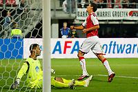 ALKMAAR - AZ - Aalesunds, voetbal,  seizoen 2011-2012, 25-08-2011, Europa League, AFAS Stadion, 6-0, AZ speler Maarten Martens (r) heeft de 3-0 achter Aalesunds speler Sten Grytebust (l) geschoten.