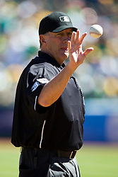 OAKLAND, CA - SEPTEMBER 22: MLB umpire Tim McClelland #36 catches a baseball during the first inning between the Oakland Athletics and the Minnesota Twins at O.co Coliseum on September 22, 2013 in Oakland, California. The Oakland Athletics defeated the Minnesota Twins 11-7 as they clinched the American League West Division. (Photo by Jason O. Watson/Getty Images) *** Local Caption *** Tim McClelland