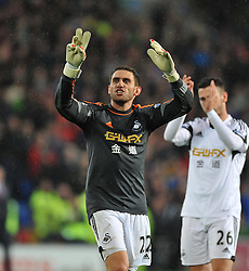 Replacement Goal keeper Swansea City's Angel Rangel signals to the swansea fans. - Photo mandatory by-line: Alex James/JMP - Tel: Mobile: 07966 386802 03/11/2013 - SPORT - FOOTBALL - The Cardiff City Stadium - Cardiff - Cardiff City v Swansea City - Barclays Premier League