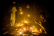 20th November 2014, New Delhi, India. Believers pray, make offerings and ask for wishes to be granted by Djinns in the ruins of Feroz Shah Kotla in New Delhi, India on the 20th November 2014<br /> <br /> PHOTOGRAPH BY AND COPYRIGHT OF SIMON DE TREY-WHITE a photographer in delhi<br /> + 91 98103 99809. Email: simon@simondetreywhite.com<br /> <br /> People have been coming to Firoz Shah Kotla to leave written notes and offerings for Djinns in the hopes of getting wishes granted since the late 1970's. <br /> Feroz Shah Tughlaq (r. 1351–88), the Sultan of Delhi, established the fortified city of Ferozabad in 1354, as the new capital of the Delhi Sultanate, and included in it the site of the present Feroz Shah Kotla. Kotla literally means fortress or citadel. The pillar, also called obelisk or Lat is an Ashoka Column, attributed to Mauryan ruler Ashoka. The 13.1 metres high column, made of polished sandstone and dating from the 3rd Century BC, was brought from Ambala in 14th century AD under orders of Feroz Shah. It was installed on a three-tiered arcaded pavilion near the congregational mosque, inside the Sultanate's fort. In centuries that followed, much of the structure and buildings near it were destroyed as subsequent rulers dismantled them and reused the spolia as building materials.
