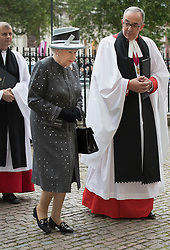 © Licensed to London News Pictures. 30/06/2016. London, UK. The Dean of Westminster Abbey, The Very Reverend Dr John Hall looks on as Queen Elizabeth II arrives for The Battle of the Somme Centenary Service and Vigil at Westminster Abbey. An overnight vigil at the Grave of the Unknown Warrior will start tonight and end at 0730 tomorrow morning. Photo credit: Peter Macdiarmid/LNP