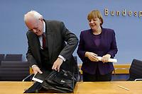 """04 FEB 2003, BERLIN/GERMANY:<br /> Roman Herzog (L), Bundespraesident a.D., und Angela Merkel (R), CDU Bundesvorsitzende, nach einer Pressekonferenz zur Vorstellung der CDU Kommission """"Soziale Sicherheit"""" unter Leitung von Herzog, Bundespressekonferenz<br /> IMAGE: 20030204-01-034<br /> KEYWORDS:Bundespräsident, Tasche, Koffer"""