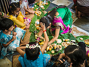 21 OCTOBER 2015 - YANGON, MYANMAR: Parents receive blessings from children during a special ceremony at the Sri Kali Temple, a Hindu temple in central Yangon.   PHOTO BY JACK KURTZ