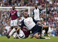 Photo: Chris Ratcliffe.<br /> West Ham United v Tottenham Hotspur. The Barclays Premiership. 07/05/2006.<br /> Shaun Newton (obscured) of West Ham brings down Edgar Davids of Spurs.