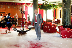 NOVI SAD, SERBIA - Monday, September 10, 2012: Wales' head of international affairs Mark Evans walks through dry ice and bubbles as the Hotel Park welcomes the players to Novi Sad ahead of the 2014 FIFA World Cup Brazil Qualifying Group A match against Serbia. (Pic by David Rawcliffe/Propaganda)