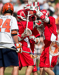 Cornell celebrates a goal against UVA. The #1 ranked Virginia Cavaliers defeated the #4 ranked Cornell Big Red 14-10 at Klockner Stadium on the Grounds of the University of Virginia in Charlottesville, VA on March 8, 2009.