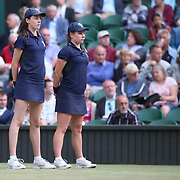 LONDON, ENGLAND - JULY 14: Ball girls in action on Center Court during the Wimbledon Lawn Tennis Championships at the All England Lawn Tennis and Croquet Club at Wimbledon on July 14, 2017 in London, England. (Photo by Tim Clayton/Corbis via Getty Images)