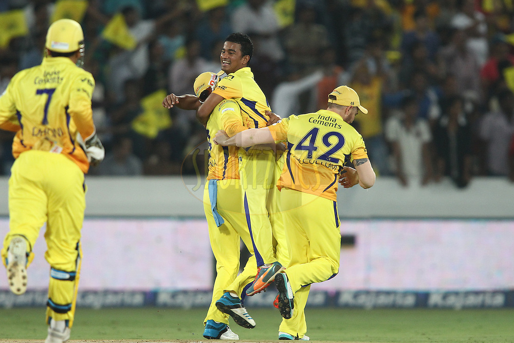Suresh Raina of the Chennai Super Kings and Brendon McCullum of the Chennai Super Kings congratulate Pawan Negi of the Chennai Super Kings for getting Thisara Perera of the Kings XI Punjab wicket  during the second semi final match of the Oppo Champions League Twenty20 between the Kings XI Punjab and the Chennai Superkings held at the Rajiv Gandhi Cricket Stadium, Hyderabad, India on the 2nd October 2014<br /> <br /> Photo by:  Shaun Roy / Sportzpics/ CLT20<br /> <br /> <br /> Image use is subject to the terms and conditions as laid out by the BCCI/ CLT20.  The terms and conditions can be downloaded here:<br /> <br /> http://sportzpics.photoshelter.com/gallery/CLT20-Image-Terms-and-Conditions-2014/G0000IfNJn535VPU/C0000QhhKadWcjYs