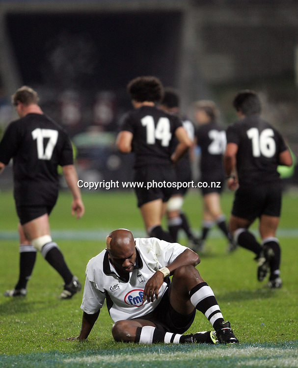 Fiji's Sam Tabua looks down after another All Black try during the All Blacks v Fiji test match played at Albany Stadium in Auckland on Friday 10 June, 2005. The All Black won 91-0. Photo: Michael Bradley/PHOTOSPORT<br />
