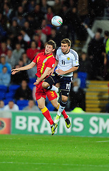 Wales Ben Davies (Swansea City) battles for the high ball with Scotland's James Morrison (West Brom) - Photo mandatory by-line: Joe Meredith/JMP  - Tel: Mobile:07966 386802 12/10/2012 - Wales v Scotland - SPORT - FOOTBALL - World Cup Qualifier -  Cardiff   - Cardiff City Stadium -