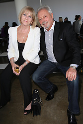Victoria Beckham's parents Tony & Jackie Adams in the front row at her Victoria show  at  New York Fashion Week, Tuesday, September 11th 2012. Photo by: Stephen Lock / i-Images. EXCLUSIVE SET OF PICS  USAGE FEE APPLIES. . Usage fees APPLIES. Contact Andrew Parsons  on 07545 311662.£500 minimum fee for use?Contact agency for fees before use.One use only repro fees apply..Mandatory Credit Stephen Lock/i-Images .Permission By Victoria Beckham has been given to use these pictures