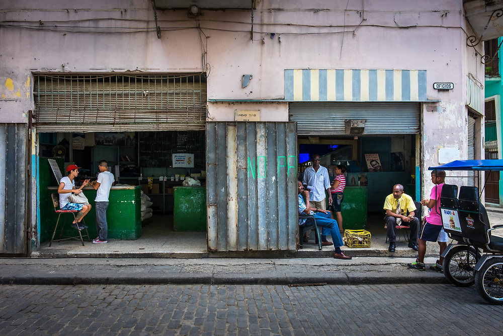 HAVANA, CUBA - CIRCA MAY 2016: Typical corner in centro Havana with locals.