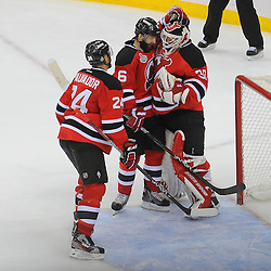 June 9, 2012: New Jersey Devils goalie Martin Brodeur (30) celebrates his team's victory with defensemen Bryce Salvador (24) and Andy Greene (6) during third period action in game 5 of the NHL Stanley Cup Final between the New Jersey Devils and the Los Angeles Kings at the Prudential Center in Newark, N.J. The Devils defeated the Kings 2-1.